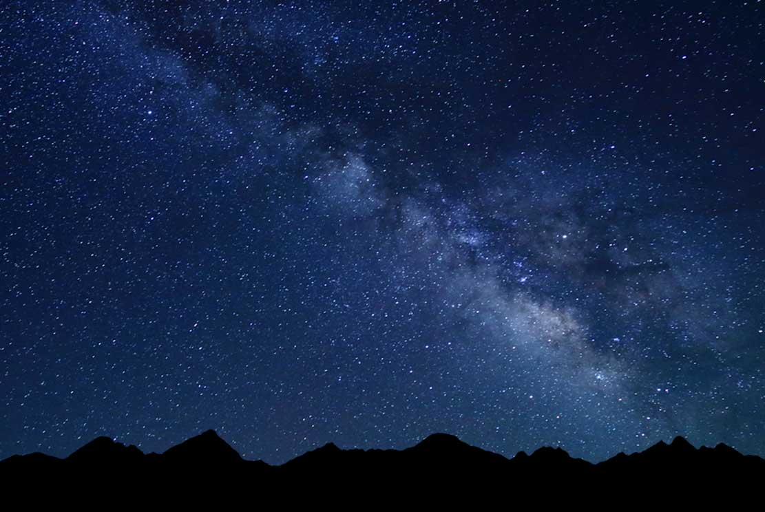 starry night with Milky way and silhouette of High Tatras mountains
