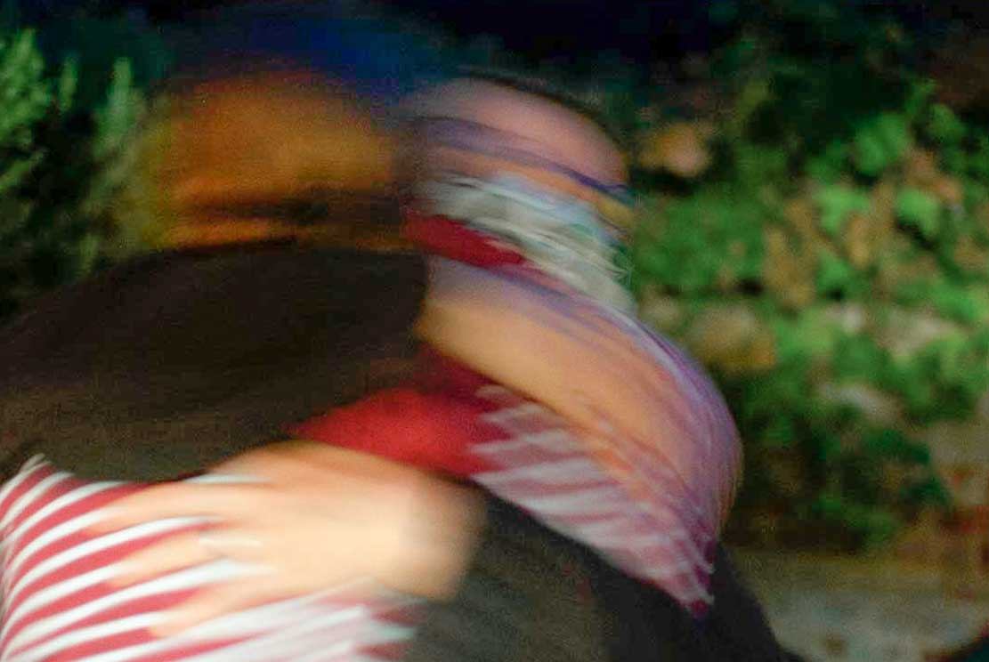 two friends hugging each other intensely while saying farewell