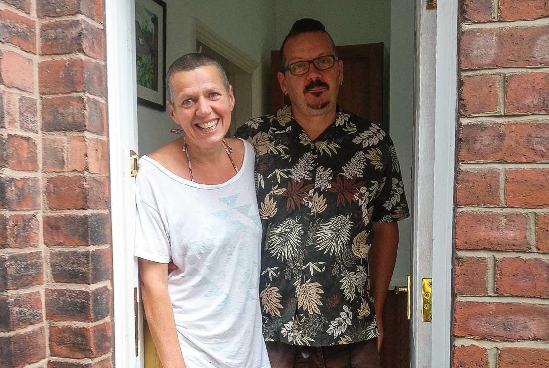 Helen and Steve, standing in their door way saying farewell