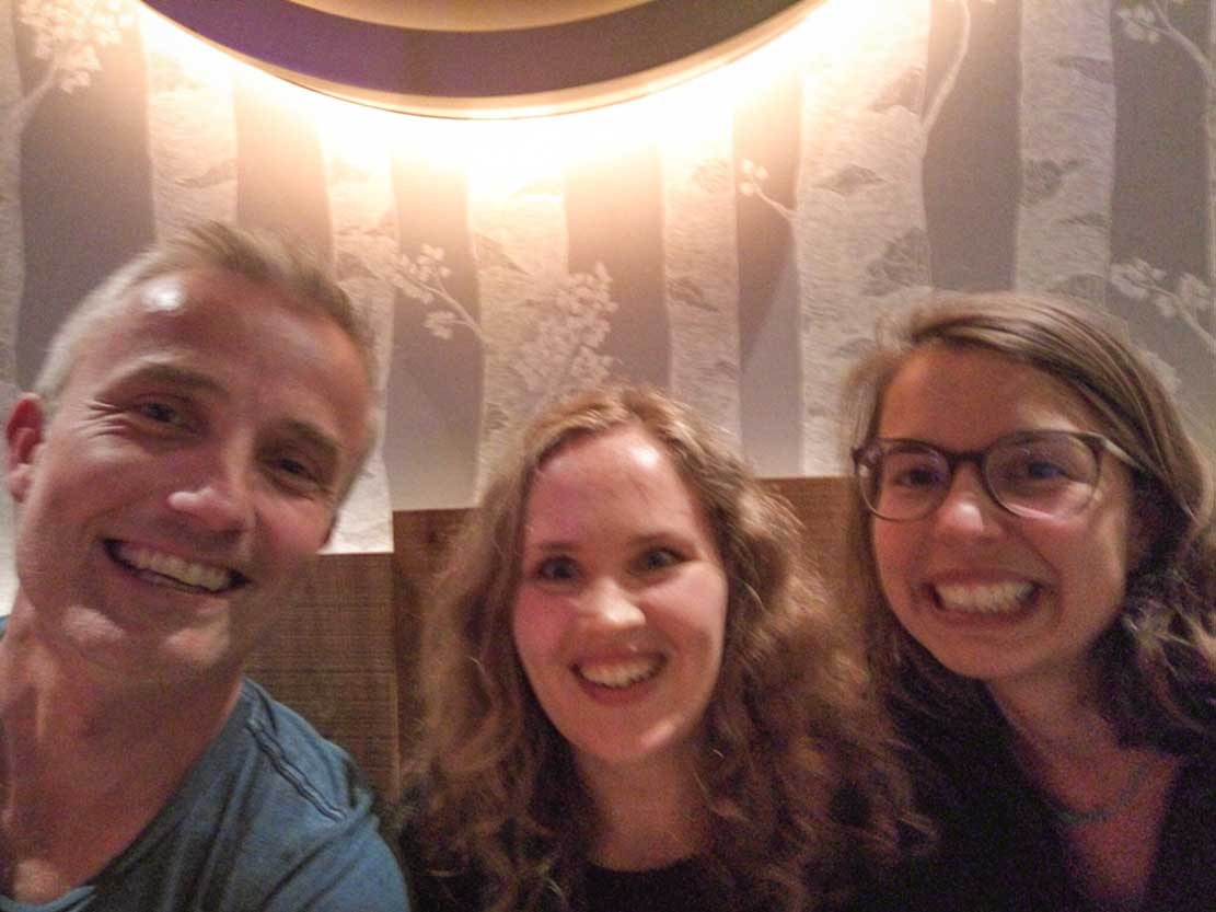 Jozef, Marit and Meline smiling after a vegan burger (delicious!) in a restaurant in Nuremberg
