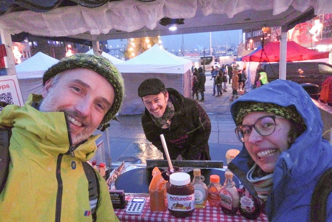 3 people around a crêperie stall in Tromsø